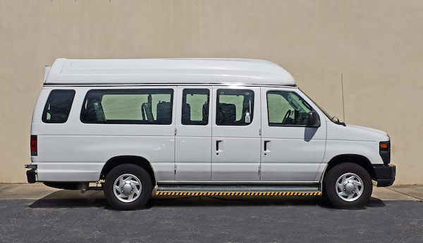 Side View Of White Ford Paratransit Wheelchair Van.