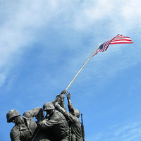 military statue holding flag