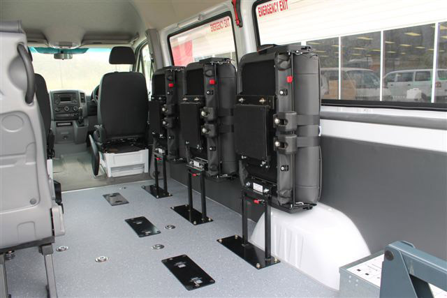 Large capacity rental vans provide flexible seating for carrying multiple wheelchair passengers.