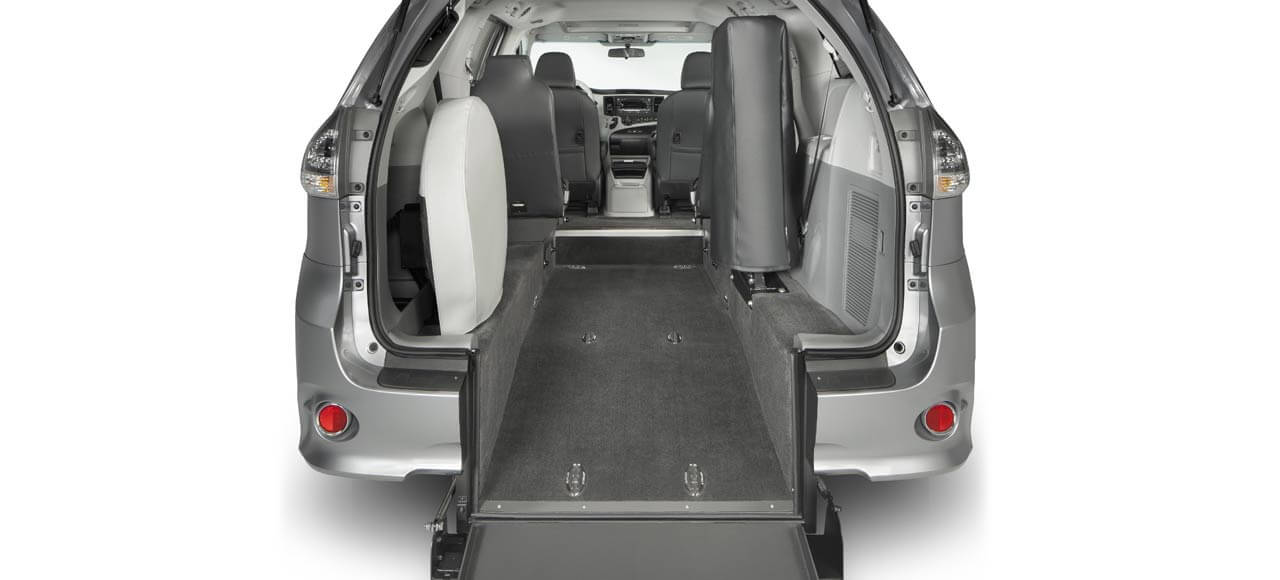 Wheelchair accesible mini van with rear entry.