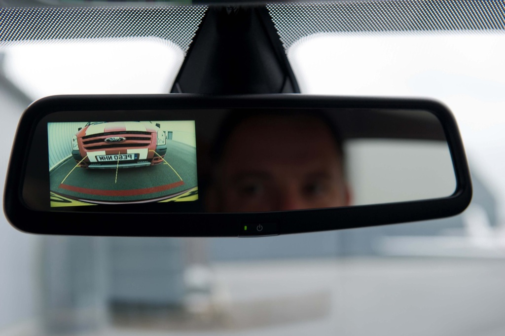 backup camera boy looking in the mirror