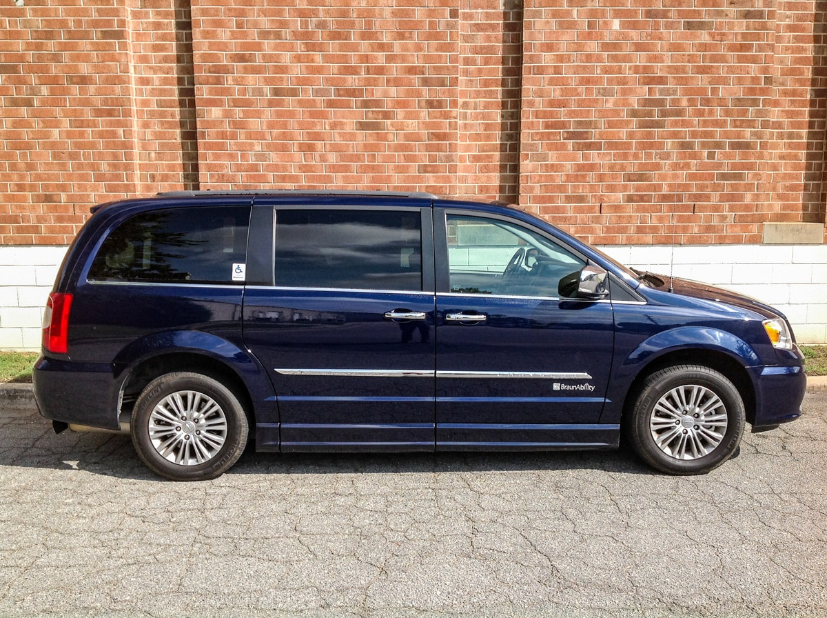 Side view of Blue Chrysler Wheelchair Minivan with side door open and ramp out.