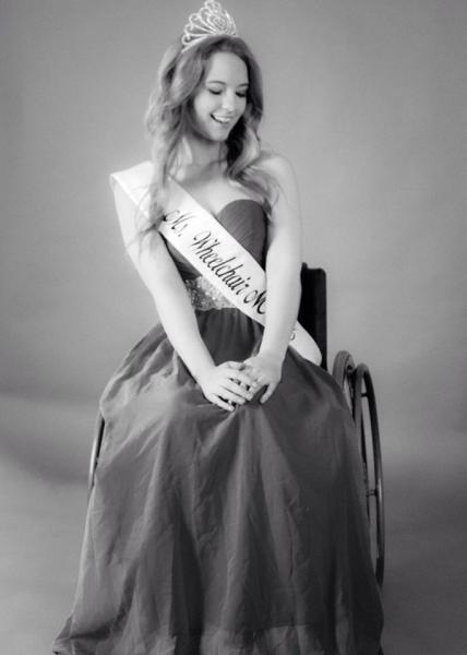 Madeline Delp, Miss Wheelchair NC USA 2017 posing in her wheel chair.
