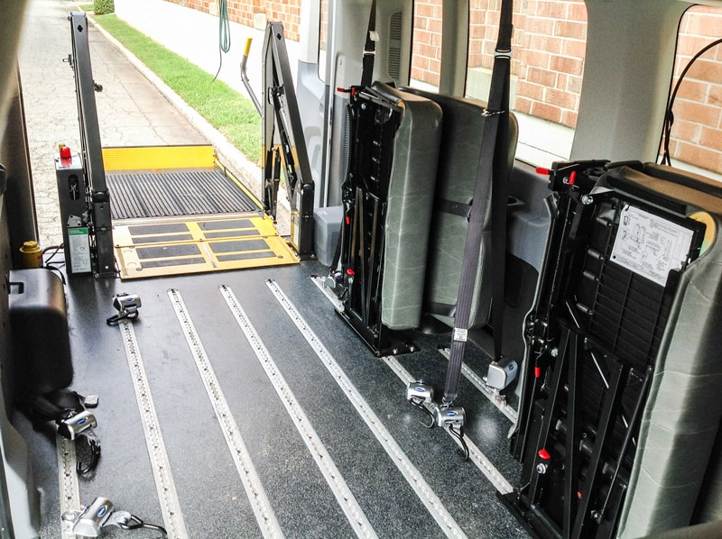 Rear entry ramp in white Ford Paratransit Wheelchair Van.