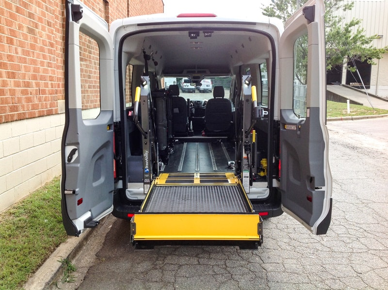 Side entry of white Ford Paratransit Wheelchair Van.