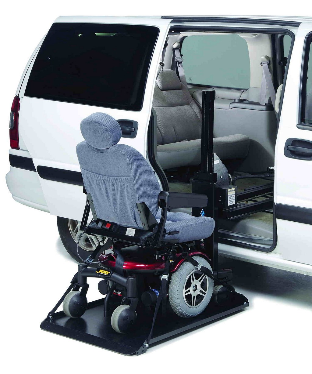 KlearVue Wheelchair Lift in a white van with wheelchair on